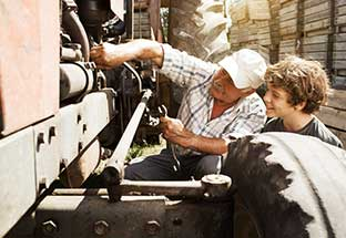 Man and boy working on an tractor