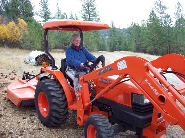 Women sitting on Kubota tractor