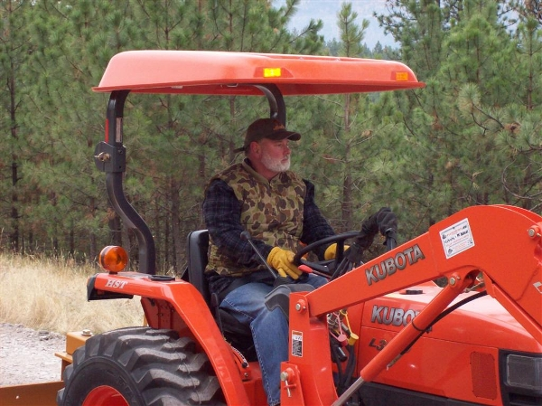 Man sitting on Kubota tractor