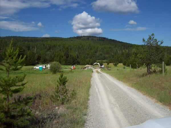 Gravel road with view of job site