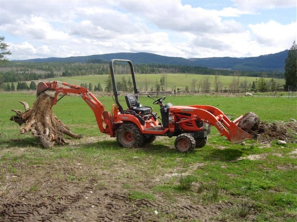 Kubota Tractor moving stump