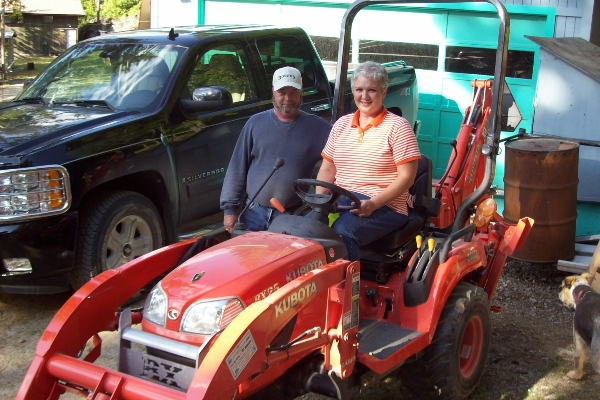 Couple with Kubota tractor