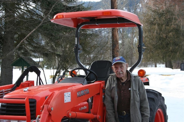 Man with Kubota tractor